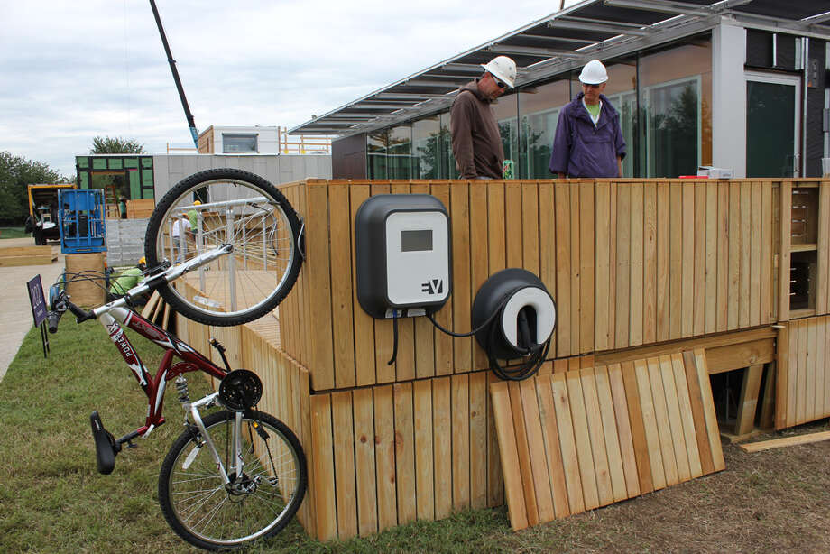 University of Tennessee students work on Living Light at the U.S. Department of Energy Solar Decathlon 2011, in Washington, D.C. The house features: