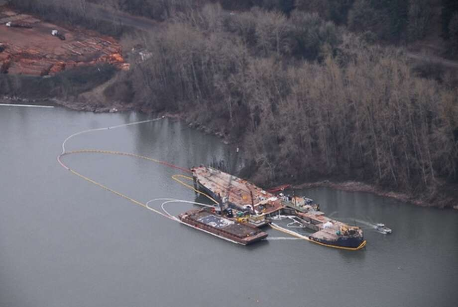 The Davy Crockett buckled and leaked oil into the Columbia River during an unpermitted salvage operation. (Photo courtest of the Wash. state Ecology Department)