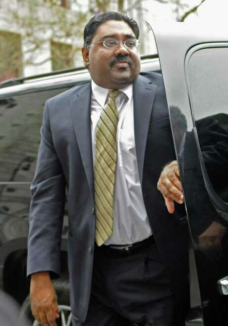 Billionaire co-founder of Galleon Group, Raj Rajaratnam, enters Manhattan federal court, Monday, April 25, 2011, in New York. The secretly taped conversations aired at the insider trading trial of Raj Rajaratnam, have given jurors a sometimes colorful dose of the go-big-or-go-home mentality at Wall Street firms.(AP Photo/ Louis Lanzano) Photo: Louis Lanzano / FR77522 AP
