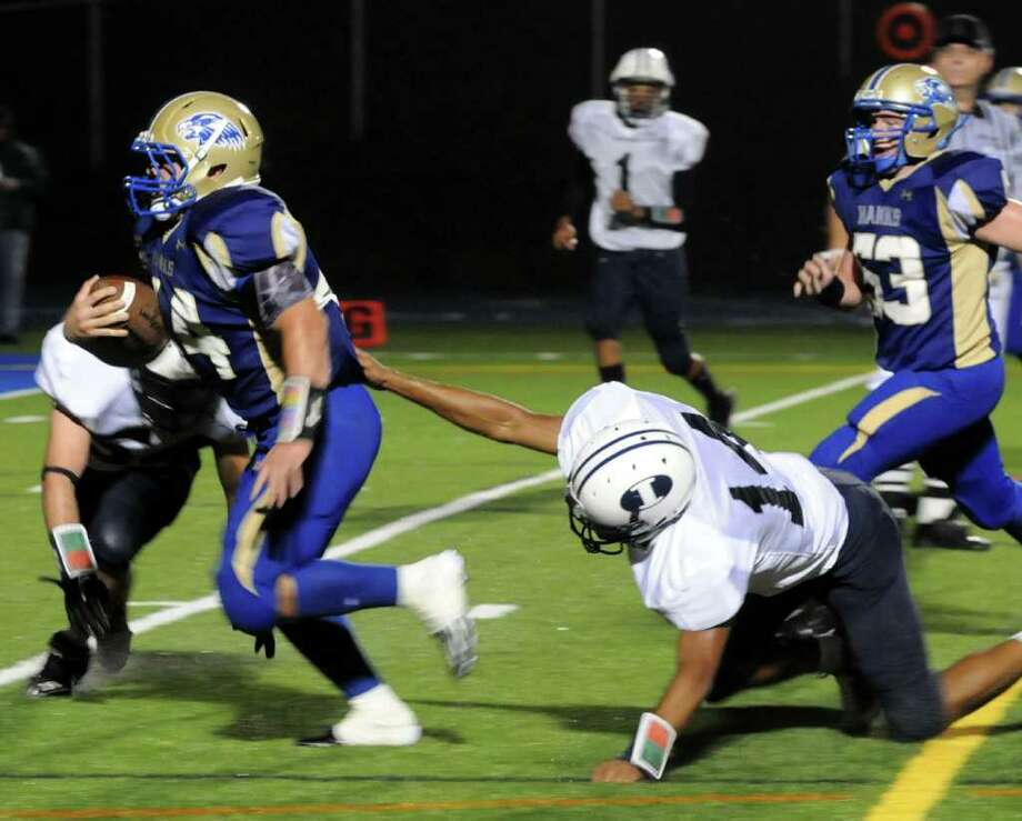 Immaculate's Sheldon Irving tries to hold Newtown's Louis Fenaroli from making a goal during the Immaculate High school vs Newtown High School football game at Newtown on Friday Sept. 23,2011. Photo: Lisa Weir / The News-Times Freelance