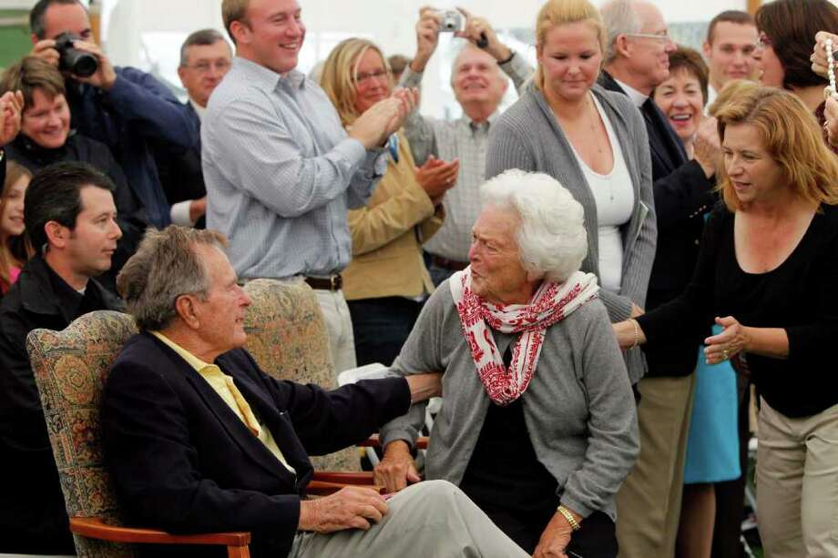 Former President Goerge H. W. Bush and former first lady Barbara Bush chat at a ceremony to unveil a new garden named in Barbara's honor, Thursday, Sept 29, 2011, in Kennebunkport, Maine. A local group donated Ganny's Garden- Barbara Bush's grandchildren call her Ganny- on  the town green. It features flowers, greens and 17 trees in honor of the Bushes' 17 grandchildren. Photo: Robert F. Bukaty, Associated Press / AP