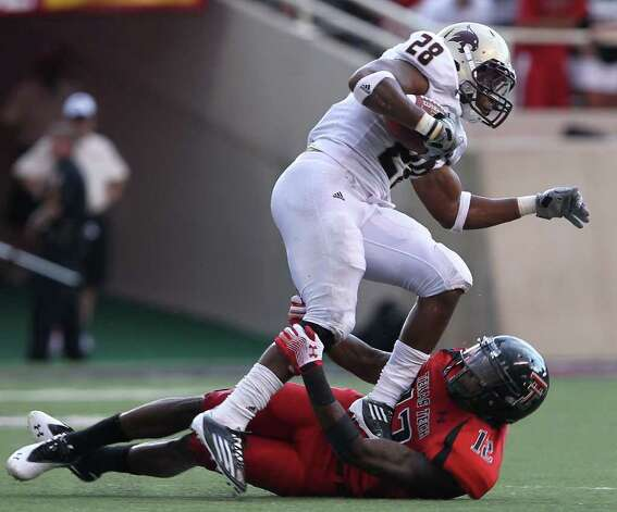 Texas Tech's D.J. Johnson tackles Texas State's Marcus Curry during their NCAA college football game at Jones AT&T Stadium in Lubbock, Texas, Saturday, Sept. 3, 2011. (AP Photo/Lubbock Avalanche-Journal,Zach Long) Photo: Associated Press