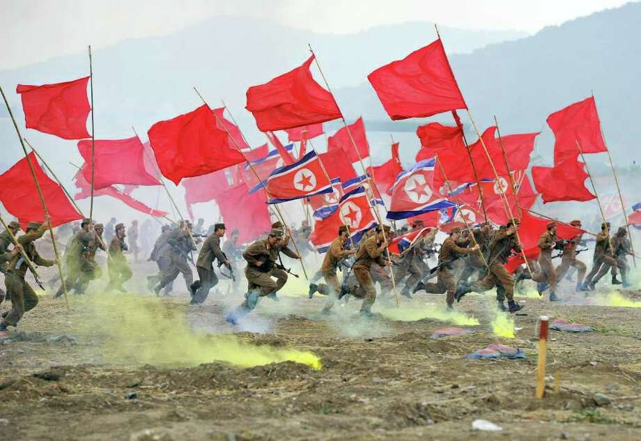 South Korean soldiers play the roles of invading North Korean soldiers during a re-enactment of the 1950 battle of Nakdong River in Chilgok, about 290 kms southeast of Seoul, to mark its 61st anniversary on September 29, 2011. The Korean peninsula is the world's last Cold War frontier as Stalinst North Korea and pro-Western South Korea have been technically at war since the 1950-53 conflict. Photo: JUNG YEON-JE, Getty / AFP