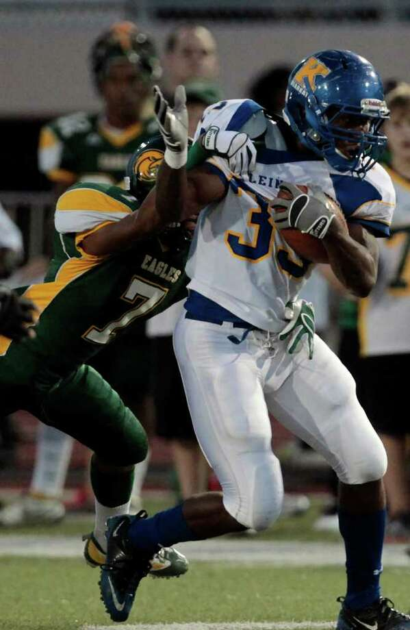 Klein High School running back David Hamm (33) is brought down by Klein Forest High School defensive back DeAndre Harris during the first quarter of a football game at Memorial Stadium Thursday, Sept. 22, 2011, in Klein.  (Cody Duty / Houston Chronicle ) Photo: Cody Duty / © 2011 Houston Chronicle