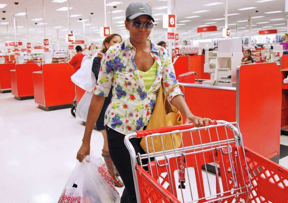 First lady Michelle Obama, wearing a hat and sunglasses, was spotted at a D.C.-area Target last week. Photo: Charles Dharapak, Associated Press / AP
