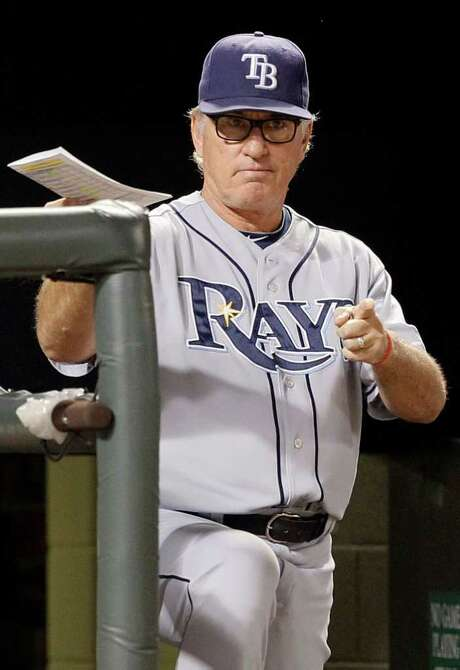 Tampa Bay Rays manager Joe Maddon gestures to one of his players in the eighth inning of a baseball game against the Baltimore Orioles on Monday, Sept. 12, 2011, in Baltimore. The Rays won 5-2. (AP Photo/Patrick Semansky) Photo: Patrick Semansky / AP