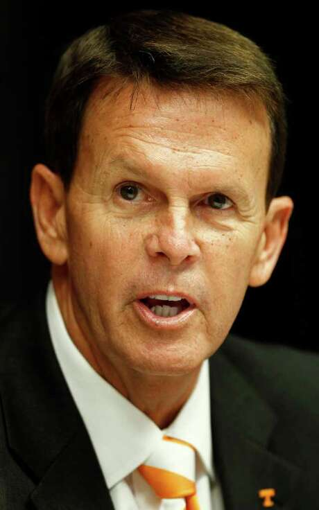"FILE - This Sept. 5, 2011 file photo shows Dave Hart at a news conference where he was introduced as the new athletic director at the University of Tennessee, in Knoxville, Tenn.  Hart says the conference realignment situation will be fluid for weeks to come. ""At some point 13 will not be the number (of teams),"" Hart told The Associated Press. (AP Photo/Wade Payne, File) Photo: Wade Payne / AP2011"