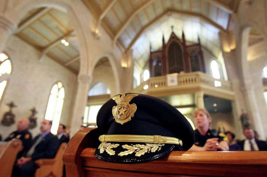 San Antonio Police Chief William McManus' hat sits on a pew at San Fernando Cathedral during the 15th annual Blue Mass on Thursday, Sept. 29, 2011. The service, also known as the Feast of Archangels, was meant to thank officers for their service. Photo: Helen L. Montoya/hmontoya@express-news.net / SAN ANTONIO EXPRESS-NEWS