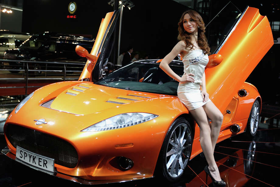 A model poses beside the Spyker C8 Aileron  during the media day of the Shanghai International Automobile Industry  Exhibition at Shanghai New International Expo Center on April 19, 2011  in Shanghai, China. / 2011 Getty Images