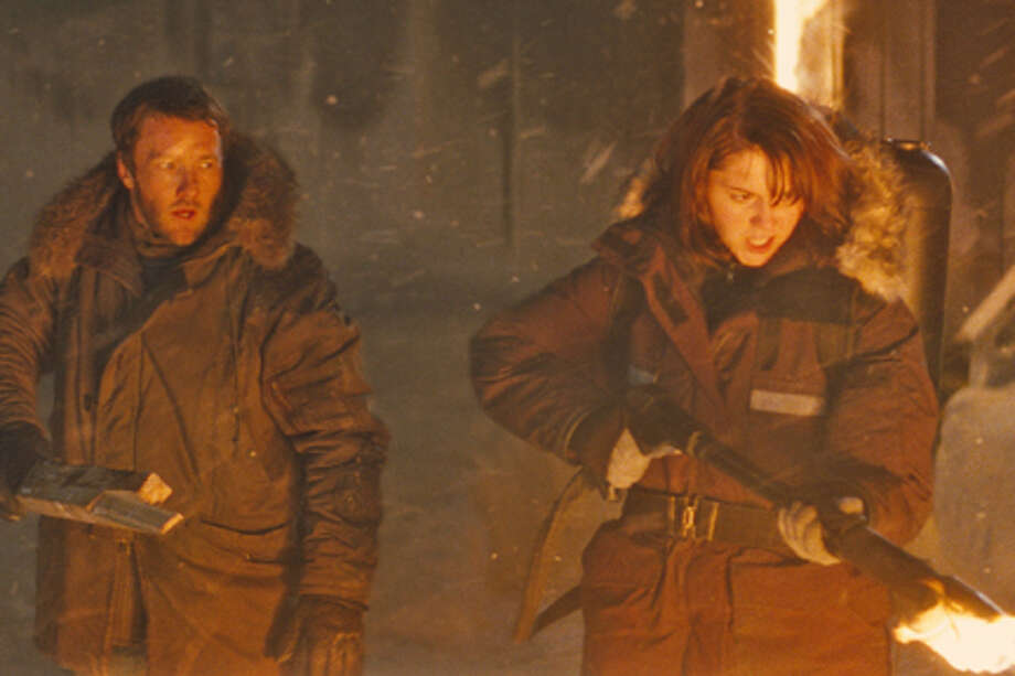 "Joel Edgerton as Sam Carter and Mary Elizabeth Winstead as Kate Lloyd in ""The Thing."""