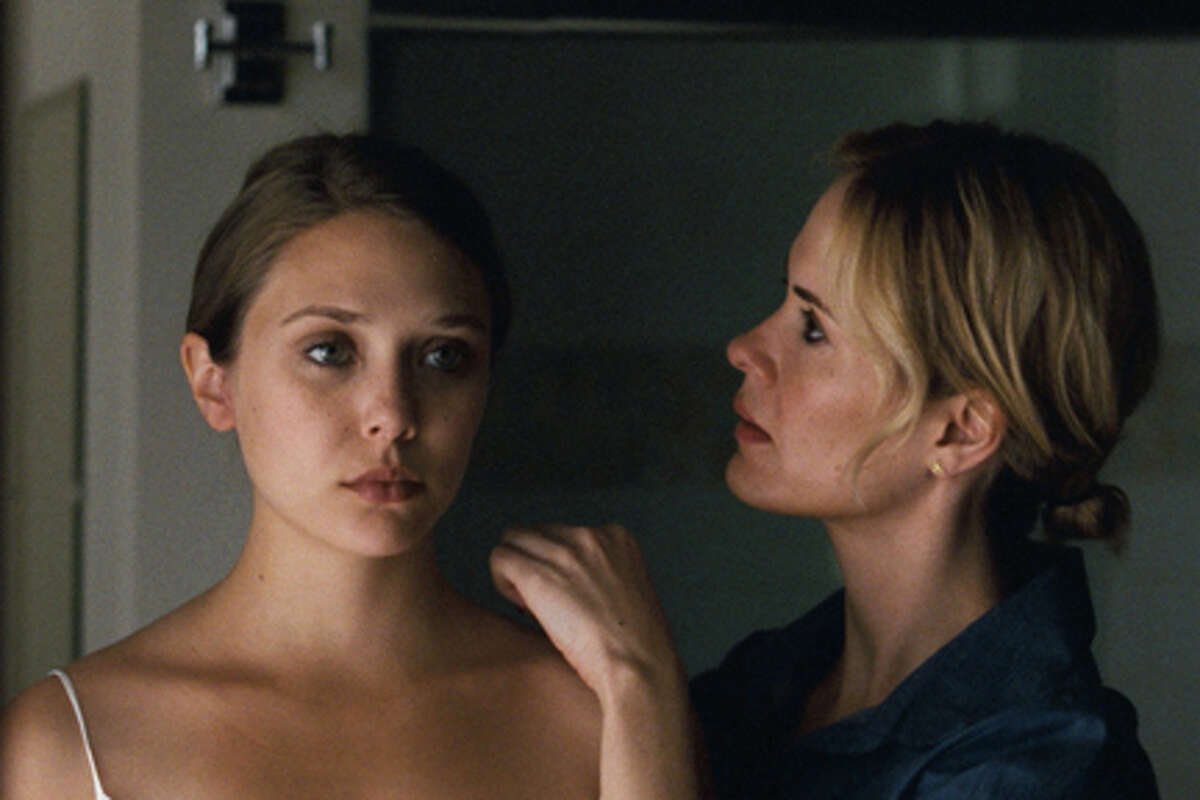 (L-R) Elizabeth Olsen as Martha and Sarah Paulson as Lucy in
