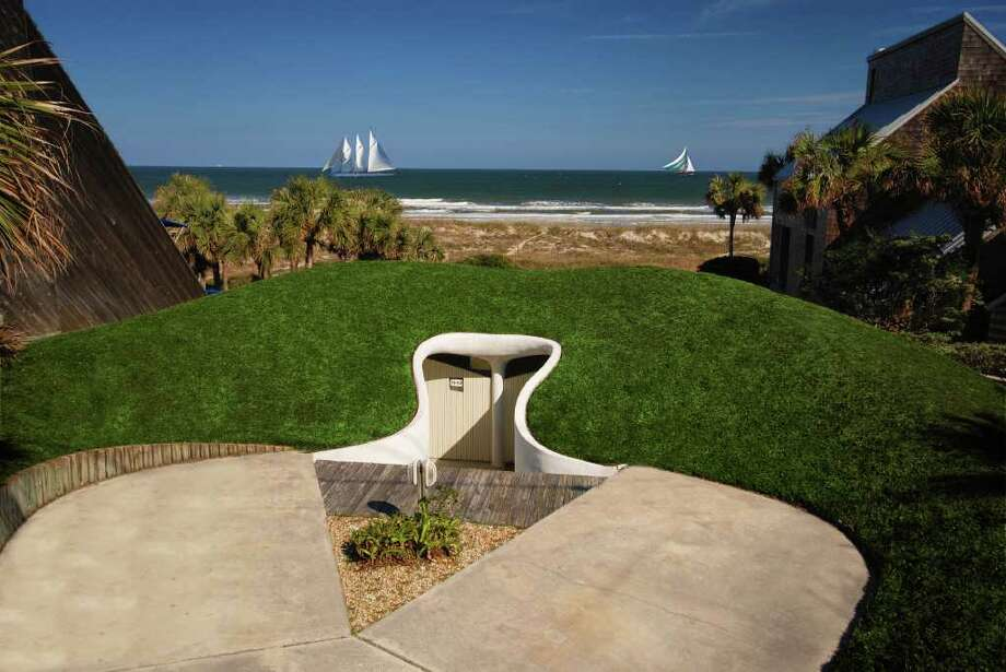 "Perhaps one of America's most unique homes, the ""Dune House"" in Atlantic Beach, Florida is built into a grassy hill. Barely rising above ground, the Dune House might be more suited to a hobbit than a human. The property consists of two duplex apartments, and is currently listed for $1.2 million by Tansy Moon of Prudential Network Realty.  Photo: Courtesy Tansy Moon/Prudential Network Realty"
