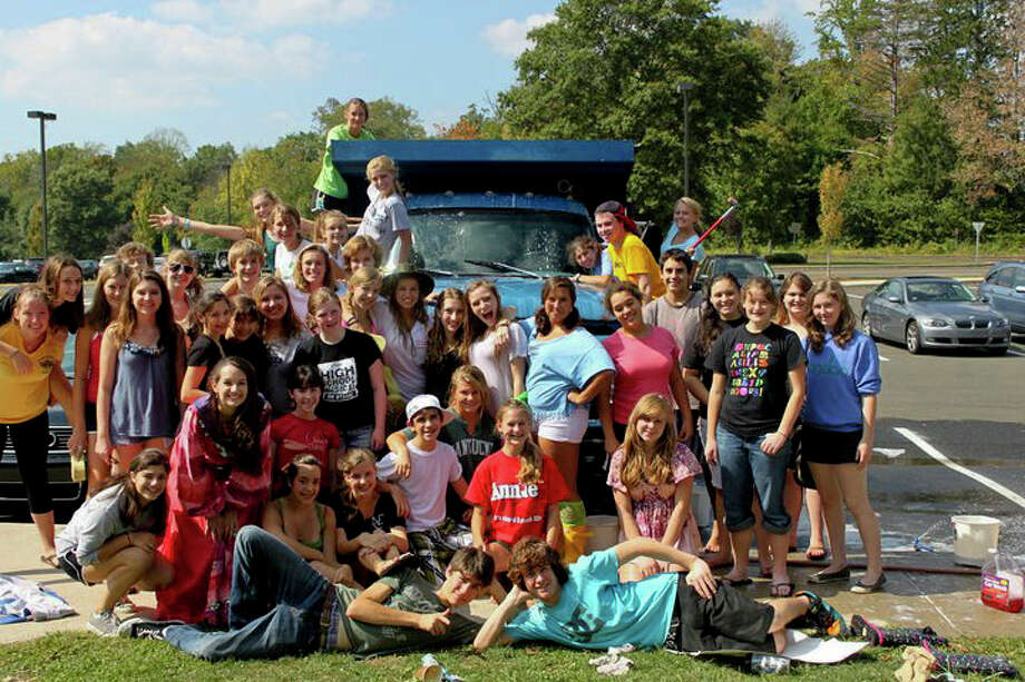 Drama students at last year's car wash and tag sale. Photo: Contributed Photo