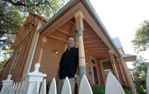 Bill McBroom stands outside his Government Hill home. The real estate agent says houses in Government Hill are cheaper than in King William. Photo: Kin Man Hui, SAN ANTONIO EXPRESS-NEWS / San Antonio Express-News