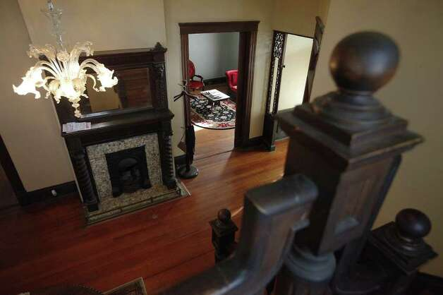 The cedar planking, handsome staircase and overall craftsmanship helped seal the deal on this home for the Riveras. Photo: Kin Man Hui, SAN ANTONIO EXPRESS-NEWS / San Antonio Express-News