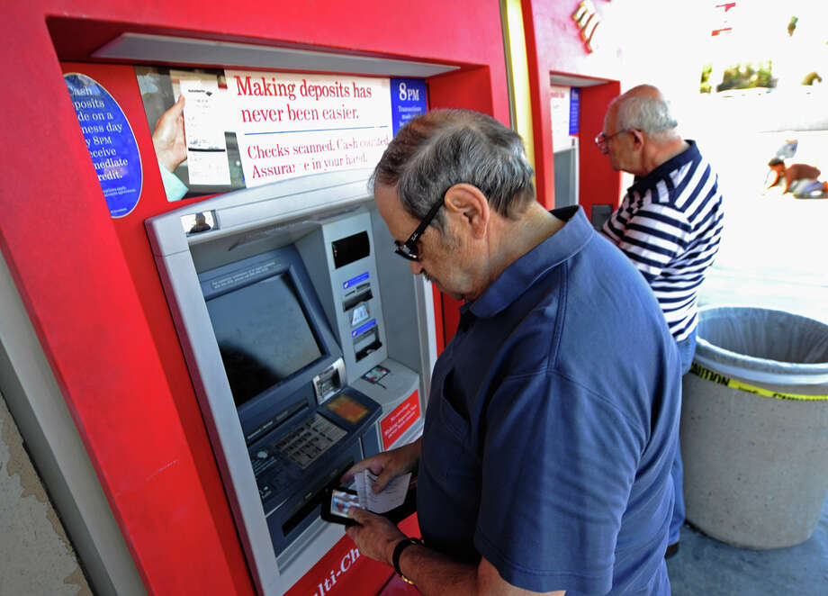 Bank of America announced it will charge $5 monthly debit-card fees, the latest in a string of fees that have sent bank customers to credit unions. (Photo by Getty). / 2011 Getty Images