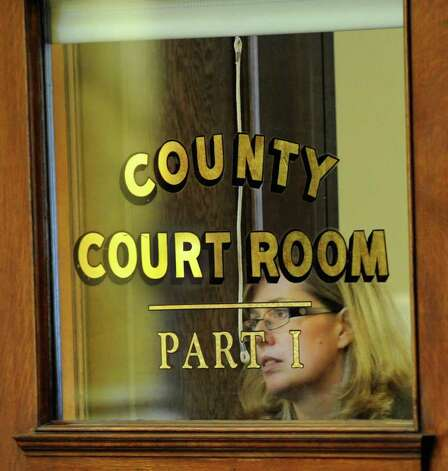 Melinda Anders McElheny leaves Rensselaer County Court in Troy, N.Y. September 30, 2011, after testifying for the defense of her husband Joseph McElheny who it is alleged that he took the life of their baby.   (Skip Dickstein / Times Union) Photo: SKIP DICKSTEIN / 00014651A