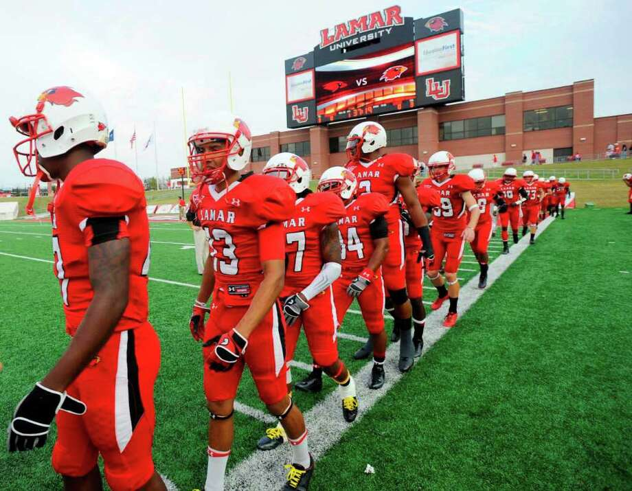 The Lamar Cardinals take the field for warmups before the start of their game against Incarnate Word at Provost Umphrey Stadium Saturday, September 17, 2011. Valentino Mauricio/The Enterprise Photo: Valentino Mauricio