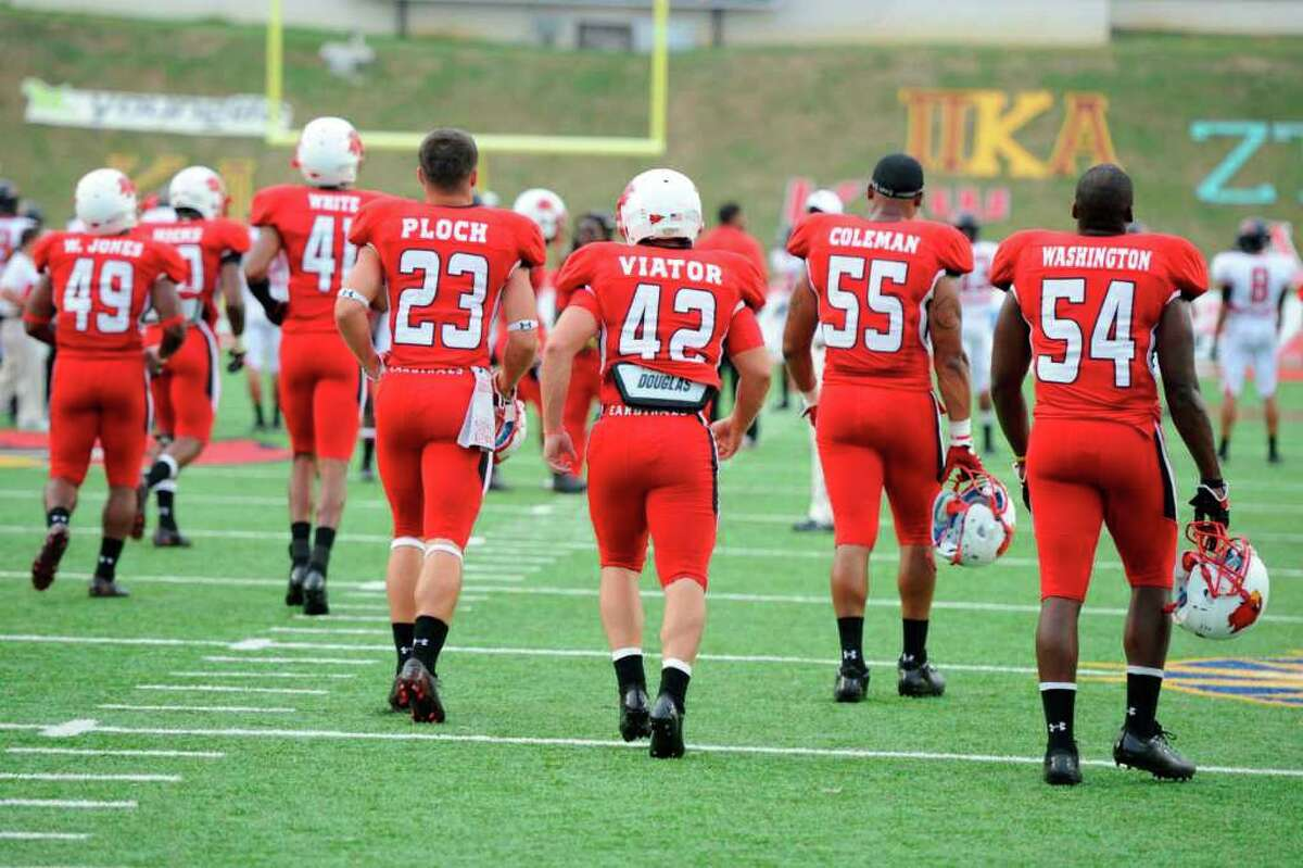 The Lamar Cardinals take the field for warmups before the start of their game against Incarnate Word at Provost Umphrey Stadium Saturday, September 17, 2011. Valentino Mauricio/The Enterprise