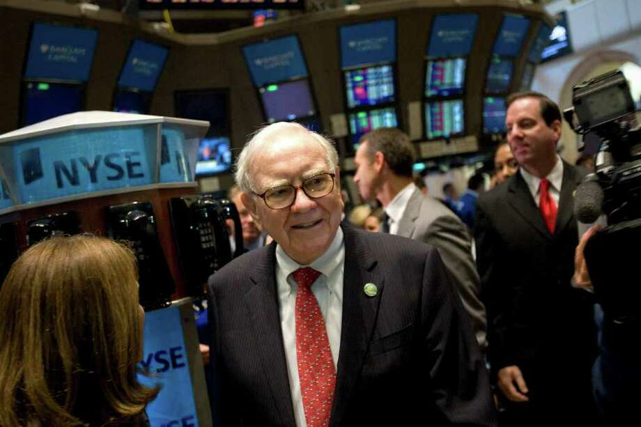 Warren Buffett, chairman and chief executive officer of Berkshire Hathaway Inc., tours the trading floor at the New York Stock Exchange (NYSE) in New York, U.S., on Friday, Sept. 30, 2011. U.S. stocks retreated, extending the biggest quarterly drop since 2008 for the Standard & Poor's 500 Index, after reports from China and Germany fueled concern the global economy is slowing. Photographer: Scott Eells/Bloomberg *** Local Caption *** Warren Buffett Photo: Scott Eells, Bloomberg / © 2011 Bloomberg Finance LP