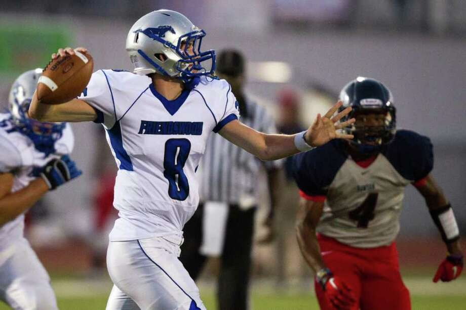 Friendswood quarterback Jordon Wood (8) gets off a pass as Dawson 's Josh Taylor (4) applies pressure during the first quarter in a high school football game at The Rig, Friday, Sept. 30, 2011, in Houston. Photo: Smiley N. Pool, Houston Chronicle / © 2011  Houston Chronicle