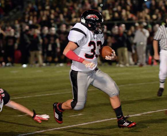 Warde's #33 Dave Wolff runs for yardage, but there was a penalty on the play as New Canaan High School hosts Fairfield Warde High School in varsity football action in New Canaan, CT on Friday, September 30, 2011. Photo: Shelley Cryan / Shelley Cryan freelance; Stamford Advocate freelance