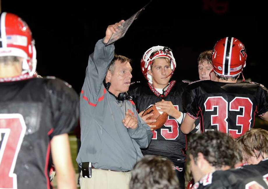 New Canaan's head coach Lou Marinelli instructs on the sidelines as New Canaan High School hosts Fairfield Warde High School in varsity football action in New Canaan, CT on Friday, September 30, 2011. Photo: Shelley Cryan / Shelley Cryan freelance; Stamford Advocate freelance