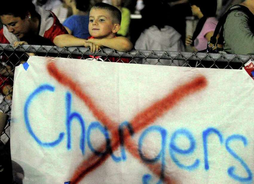Young Derby fan Michael Hyder, 7, of Derby, watches the Derby Vs Ansonia football game in Derby, Conn. on Friday September 30, 2011.