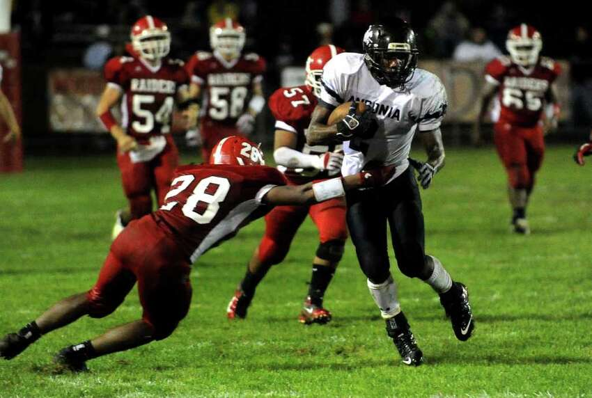 Ansonia's #2 Arkeel Newsome, right, prepares to evade Derby's #28 Tyrae Small, to run the ball to the endzome for a touchdown, during boys football action in Derby, Conn. on Friday September 30, 2011.