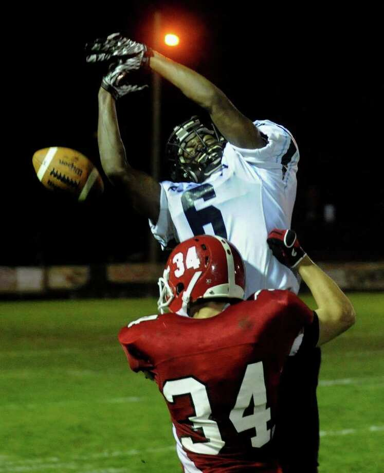 Ansonia's #6 Raeshaun Finney, top, tries to intercept a pass intended for Derby's #34 Brian Dobek, during boys football action in Derby, Conn. on Friday September 30, 2011. Photo: Christian Abraham / Connecticut Post