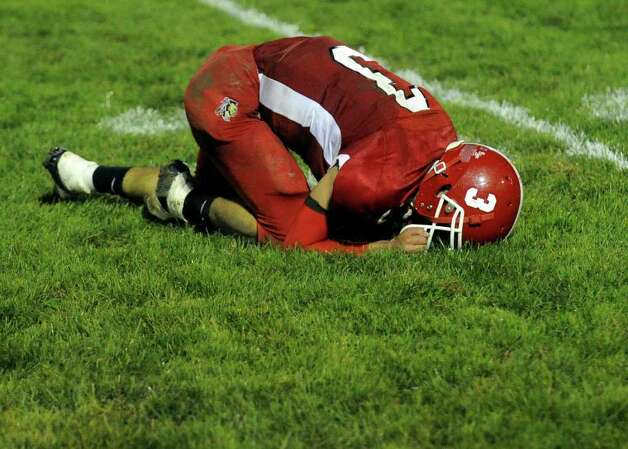Derby's #3Hector Vazquez kneels on the field dejected for not being able to tackle Ansonia's Arkeel Newsome in his drive for a touchdown, during boys football action in Derby, Conn. on Friday September 30, 2011. Photo: Christian Abraham / Connecticut Post