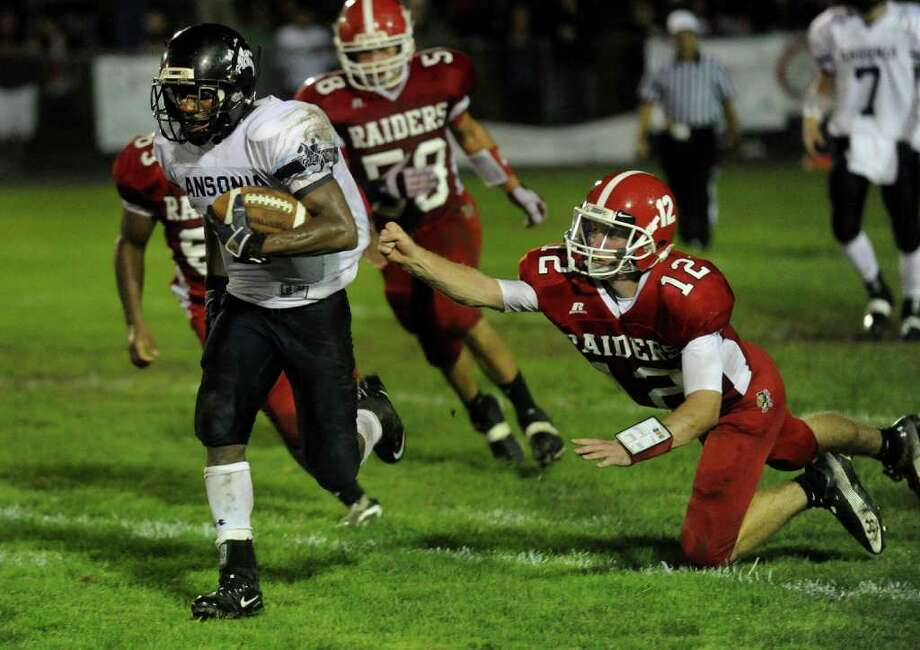 Derby's #12 Ray Kreiger, right, fails to get a hold of Ansonia's Arkeel newsome, during boys football action in Derby, Conn. on Friday September 30, 2011. Photo: Christian Abraham / Connecticut Post