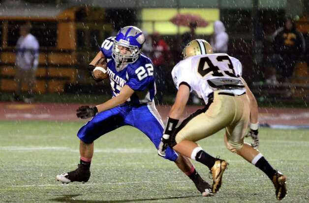 Fairfield Ludlowe's Stephen Scholz sidesteps a tackle by Trumbull's defense during the football game at Fairfield Ludlowe High School on Friday, Sept. 30, 2011. Photo: Amy Mortensen / Connecticut Post Freelance
