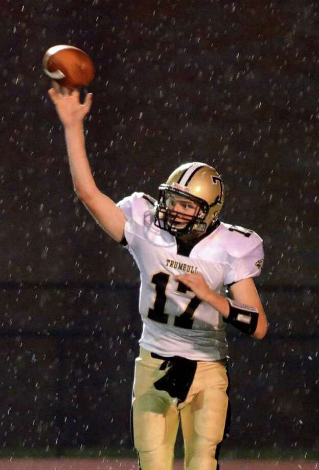 Trumbull's Nick Roberts throws a pass as the rain starts to fall during the football game against Fairfield Ludlowe at Fairfield Ludlowe High School on Friday, Sept. 30, 2011. Photo: Amy Mortensen / Connecticut Post Freelance