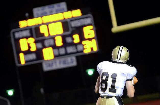 Trumbull's Adam Bissell runs into the endzone scoring a touchdown during the football game against Fairfield Ludlowe at Fairfield Ludlowe High School on Friday, Sept. 30, 2011. Photo: Amy Mortensen / Connecticut Post Freelance