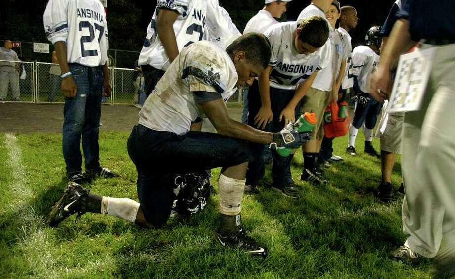 Highlights from boys football action between Derby and Ansonia in Derby, Conn. on Friday September 30, 2011. Ansonia's #2 Arkeel Newsome takes a breather after a touchdown run. Photo: Christian Abraham / Connecticut Post