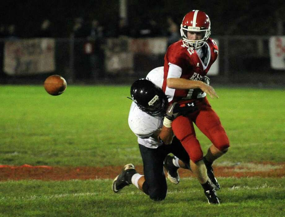 Highlights from boys football action between Derby and Ansonia in Derby, Conn. on Friday September 30, 2011. bnDerby's #12 Ray Kreiger gets sacked. Photo: Christian Abraham / Connecticut Post