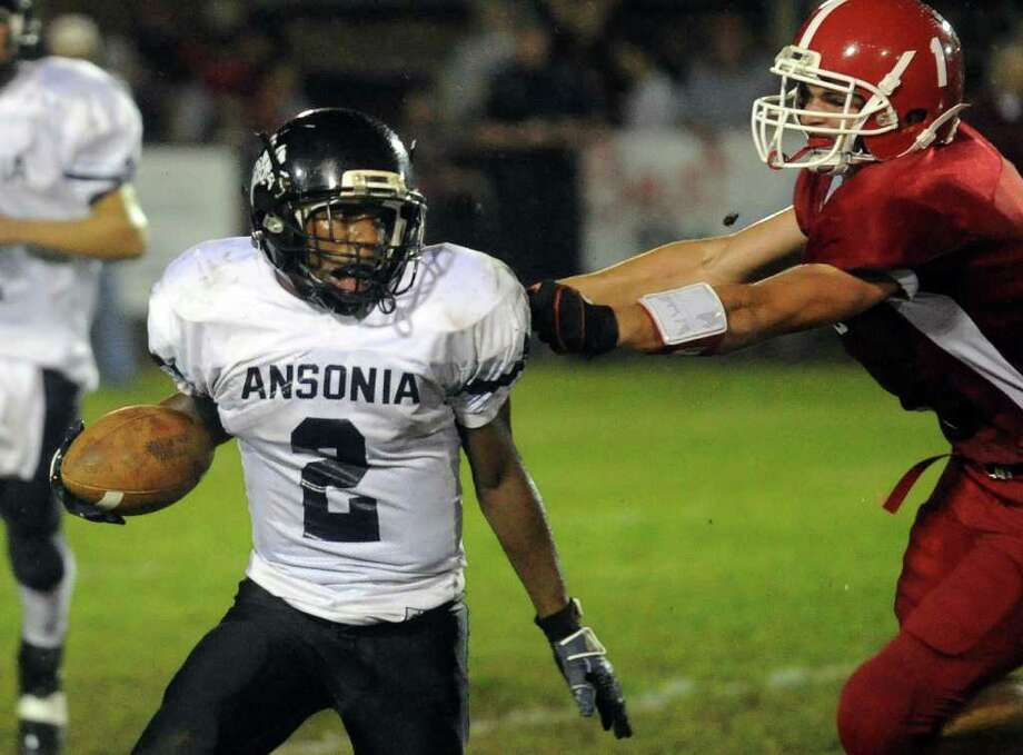 Highlights from boys football action between Derby and Ansonia in Derby, Conn. on Friday September 30, 2011. Ansonia's #2 Arkeel Newsome, left, avoids Derby's #1 Tim Adanti. Photo: Christian Abraham / Connecticut Post