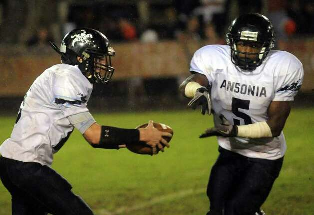 Highlights from boys football action between Derby and Ansonia in Derby, Conn. on Friday September 30, 2011. Ansonia QB Tyler Lester, left, pulls back with a fake handoff to #5 Jai Quan McKnight. Photo: Christian Abraham / Connecticut Post