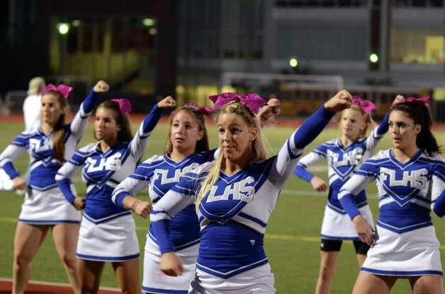 Fairfield Ludlowe cheerleaders perform during the football game against Trumbull at Fairfield Ludlowe High School on Friday, Sept. 30, 2011. Photo: Amy Mortensen / Connecticut Post Freelance