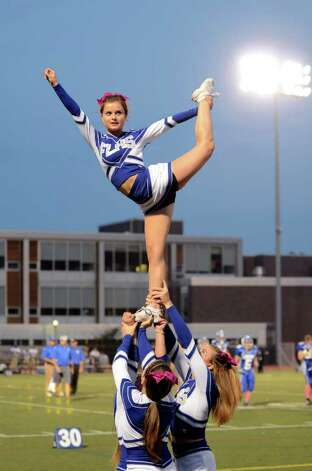 Fairfield Ludlowe cheerleaders perform on the sideline during the football game against Trumbull at Fairfield Ludlowe High School on Friday, Sept. 30, 2011. Photo: Amy Mortensen / Connecticut Post Freelance