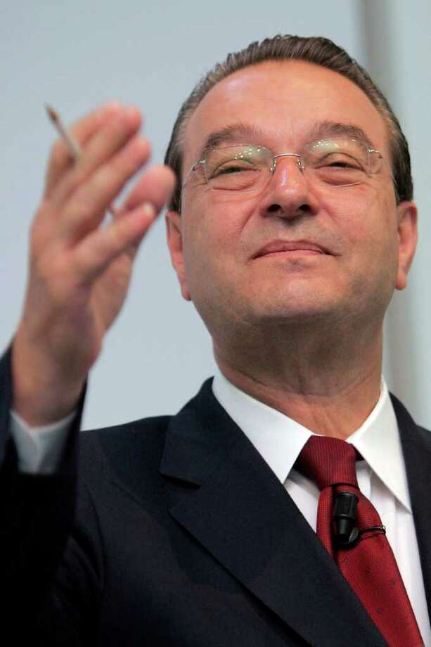 In this file photo, then Credit Suisse CEO Oswald J. Gruebel gestures during a news conference in Zurich, Switzerland. Gruebel resigned over a $2.3 billion rogue trading loss. (AP Photo/Keystone, Alessandro Della Bella, File) Photo: Alessandro Della Bella, Associated Press / KEYSTONE