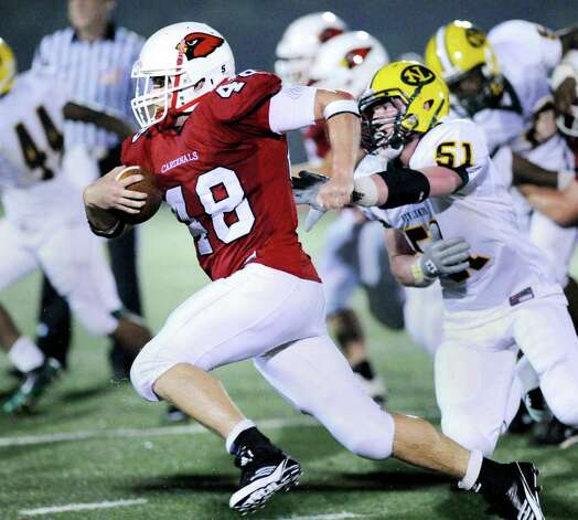 Running back Shane Nastahowski, # 48 of Greenwich High School goes past Brendan McNeil, # 51 of New London during High School football game between New London High School and Greenwich High School at Greenwich, Friday night, Sept. 30, 2011.  New London defeated Greenwich 51-33. Photo: Bob Luckey / Greenwich Time