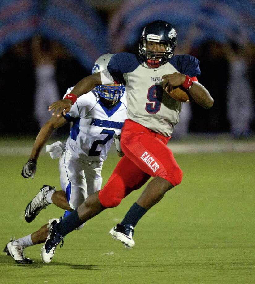 Dawson quarterback Garry Kimble (9) races past Friendswood defensive back Caleb Taube (2) during the second quarter in a high school football game at The Rig. Photo: Smiley N. Pool, Houston Chronicle / © 2011  Houston Chronicle