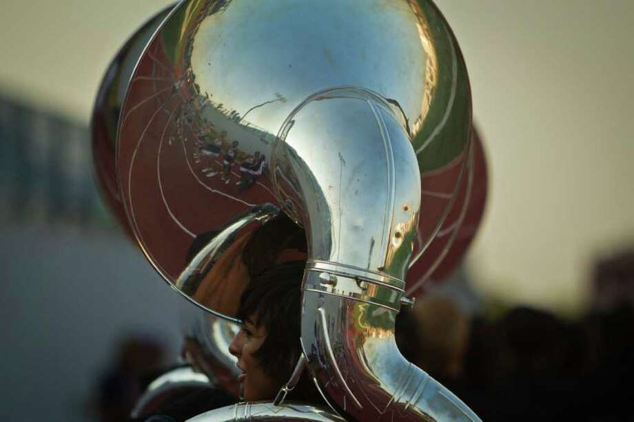 Dawson cheerleaders are reflected in the in the horn of a band member before a high school football game against Friendswood. Photo: Smiley N. Pool, Houston Chronicle / © 2011  Houston Chronicle