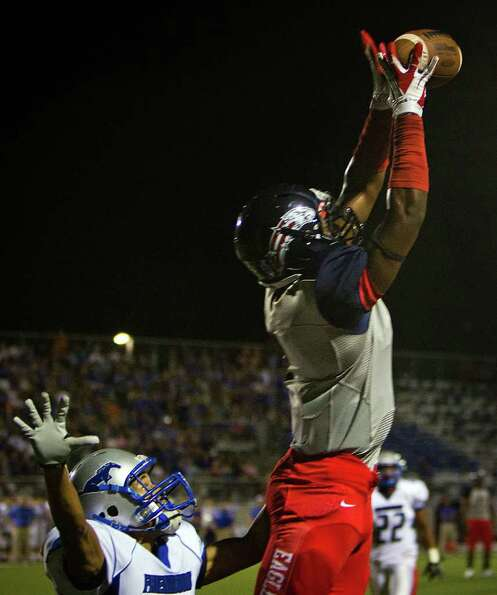 Dawson wide receiver Mike Williams leaps for a touchdown grab as Friendswood defensive back Caleb Ta