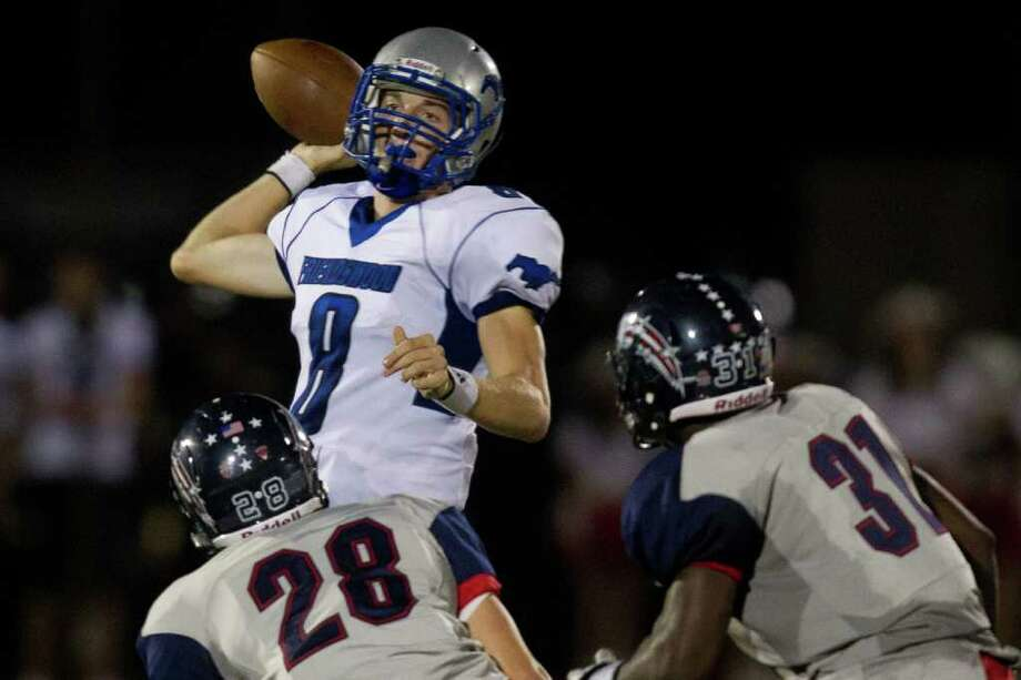 Friendswood quarterback Jordon Wood (8) gets off a pass against Dawson during the second quarter. Photo: Smiley N. Pool, Houston Chronicle / © 2011  Houston Chronicle