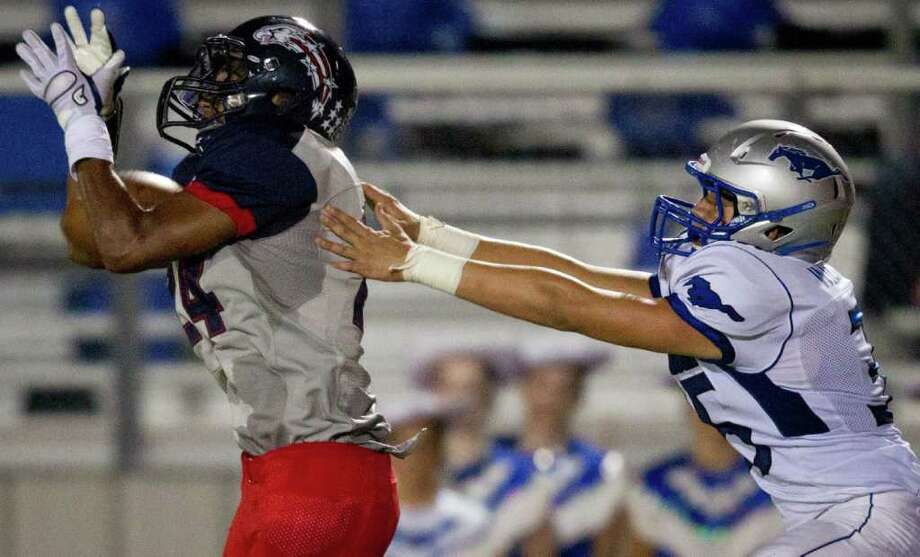 Dawson defensive back Haywood Jeffires (24) breaks up a pass intended for Friendswood's Walker Williams (35) during the second quarter. Photo: Smiley N. Pool, Houston Chronicle / © 2011  Houston Chronicle