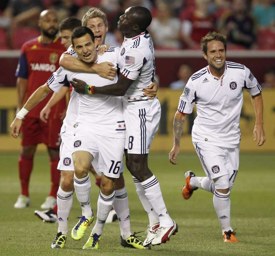 Marco Pappa, center, and the Fire remain in the MLS playoff hunt. Photo: George Frey / 2011 Getty Images