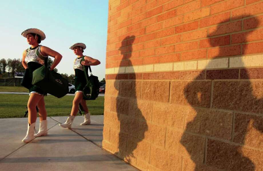 Kingwood Park High School drill team members make their way to the field before the start of a football game against Summer Creek. Photo: Cody Duty, Houston Chronicle / © 2011 Houston Chronicle